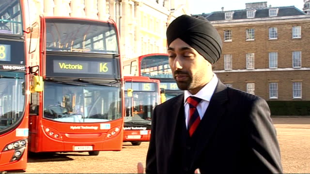 trial of hybrid buses in london red doubledecker hybrid bus slowly past kulveer ranger interview sot saying buses are very quiet interior of empty... - bodywork stock videos & royalty-free footage