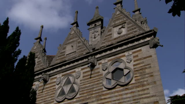Triangular details symbolize the Holy Trinity on the limestone facade of the Rushton Triangular Lodge. Available in HD.