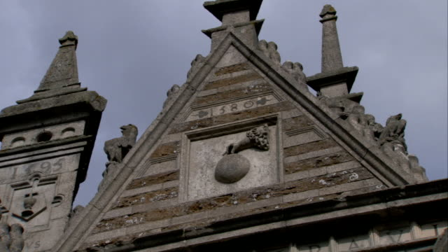 a triangular gable with ornate stonework tops the roofline of rushton triangular lodge in northamptonshire. available in hd. - gable stock videos & royalty-free footage
