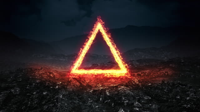 triangular shape made by the flame of fire on an unknown abandoned planet. - pyramid stock videos and b-roll footage