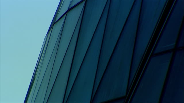 triangular windows adorn the exterior of london city hall. available in hd. - gla building stock videos & royalty-free footage