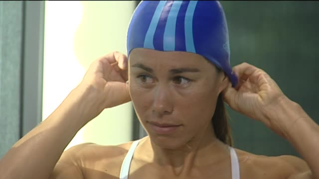 triathlete andrea hewitt swimming in pool during training - triathlete stock videos and b-roll footage