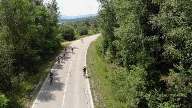 triathletes cycling on a triathlon race - medallist stock videos & royalty-free footage