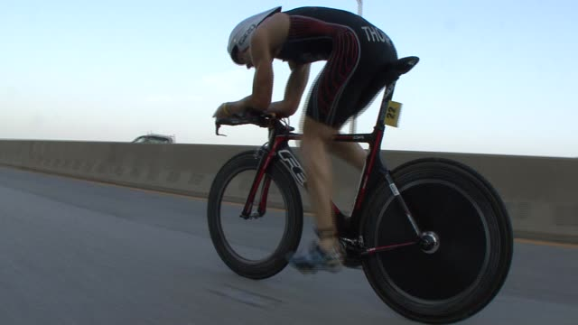 stockvideo's en b-roll-footage met triathletes in the nyc triathlon swim in hudson river cycle on west side drive and run in central park cyclist on west side drive low angle - salmini