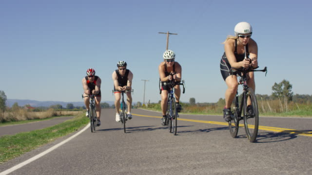 triathletes training for a triathlon - competitive sport stock videos & royalty-free footage