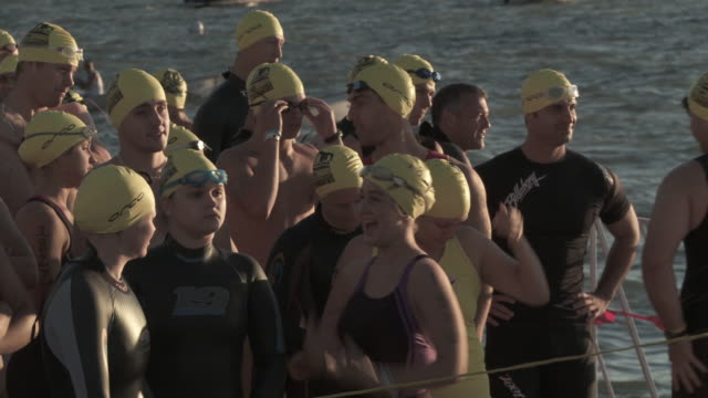 ms triathletes waiting for swim start / chicago, illinois, usa - swimming cap stock videos & royalty-free footage