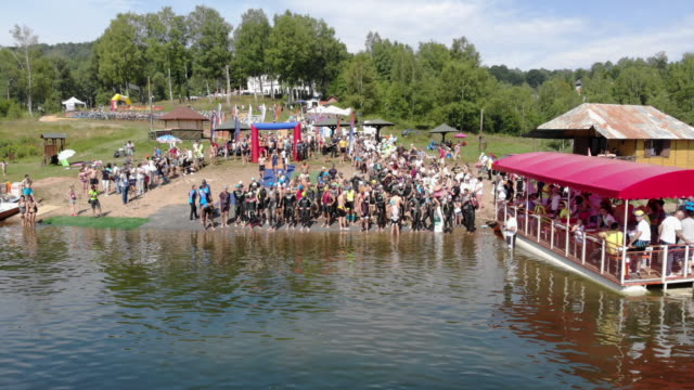 triathletes waiting start of the race - triathlon stock videos & royalty-free footage