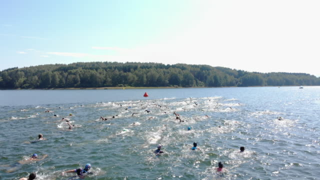 triathlon swimmers in lake - triathlon stock videos & royalty-free footage
