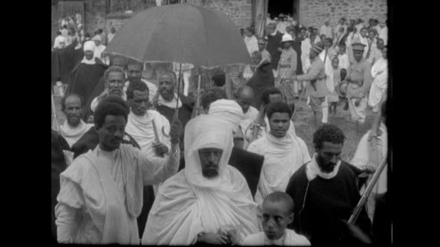 tribal chiefs, warlords surrounded by retinues of soldiers ride into adis ababa to pledge help to haile selassie / people of adis ababa pass by... - war stock-videos und b-roll-filmmaterial