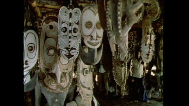 tribal masks for sale in tourist market; papua new guinea, 1985 - bbc archive stock-videos und b-roll-filmmaterial