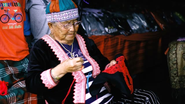 tribal old woman doing embroidery - pullover stock videos & royalty-free footage