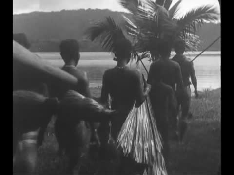 tribal people covering each other with tattoo/ portraits of andamanese people/ tribal woman with human skull on her neck/ anadamanese going fishing - human neck stock videos & royalty-free footage