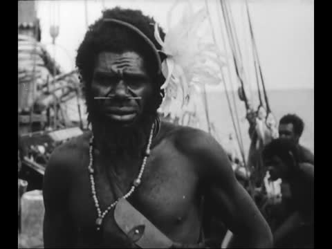 tribal people on a shore/ portraits of melanesians with riffles/ tribal people on missionary boat - missionary stock videos & royalty-free footage