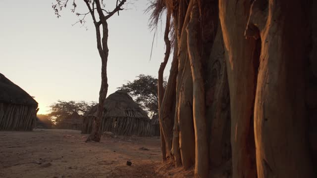 tribal village during sunrise in angola - village stock videos & royalty-free footage