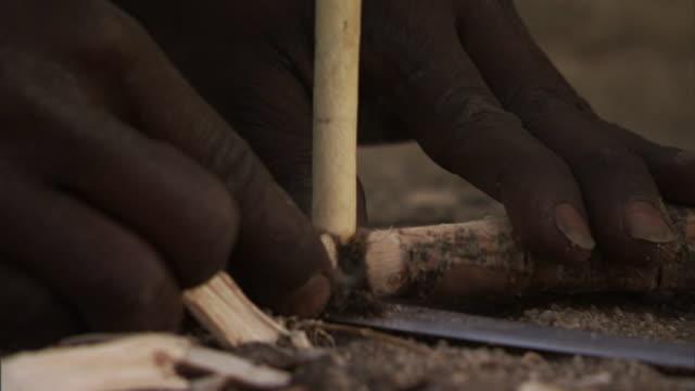 tribesmen build a fire with sticks. - indigene kultur stock-videos und b-roll-filmmaterial