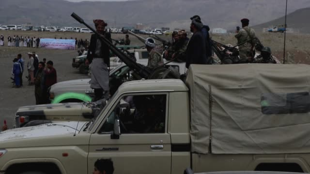 tribesmen loyal to the houthi group are seen on trucks mounted with machine guns during an armed tribal gathering supporting the forces of the houthi... - war stock videos & royalty-free footage