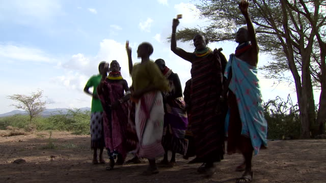 tribeswomen in kenya receiving humanitarian aid via a payment card - cards stock videos & royalty-free footage