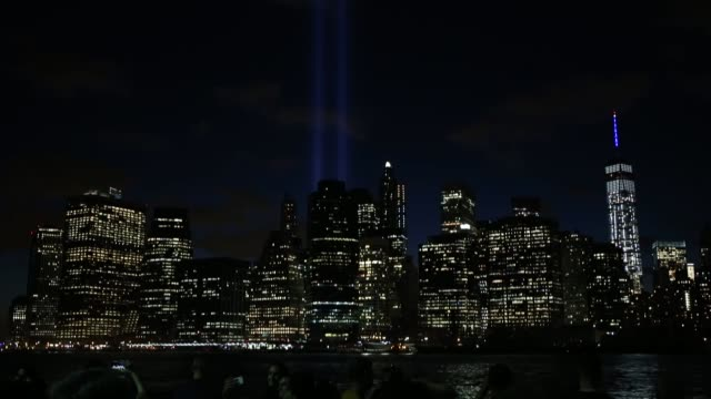 tribute in light illuminate the new york city sky between the twin towers of the world trade center in new york to mark the 14th anniversary of the... - petronas twin towers stock videos & royalty-free footage