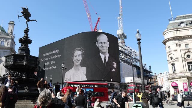tribute to prince philip billboard family photos at piccadilly circus on april 17, 2021 in london, united kingdom. the duke of edinburgh travelled... - family stock videos & royalty-free footage