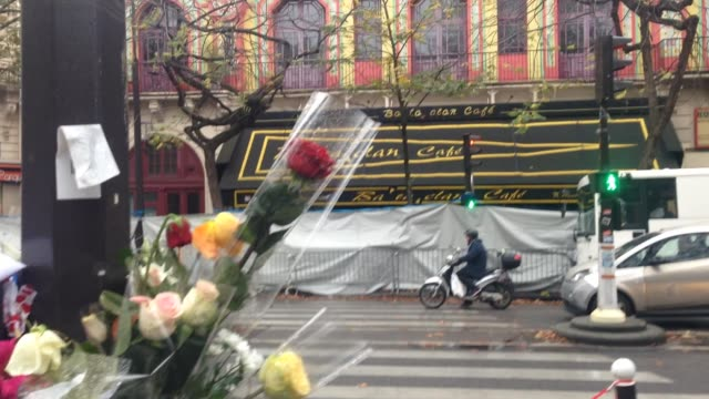 tributes and flowers are left near the 'bataclan' concert hall where terrorists killed at 89 persons during the 'eagles of death metal' concert on... - 2015 video stock e b–roll