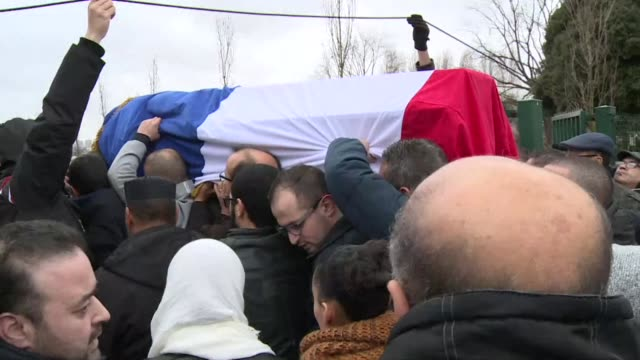 Tributes are paid to French policeman Ahmed Merabet a 40 year old Muslim who was buried in a Muslim cemetary outside Paris Tuesday