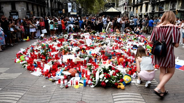 Tributes are placed on Las Ramblas near the scene of Thursday's terrorist attack on August 19 2017 in Barcelona Spain A nationwide manhunt continues...