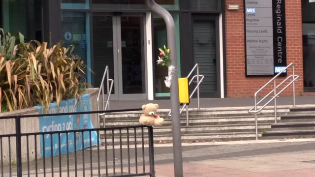 tributes have been left to a four-year-old boy who died after being hit by a car outside a medical centre. flowers and a teddy have been tied to... - teddy boy stock videos & royalty-free footage