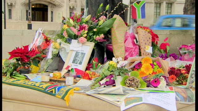 tributes to nelson mandela after his death at his statue in parliament square - bunch stock videos & royalty-free footage