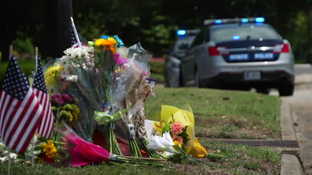 tributes to victims of a mass shooting a government building in virginia beach - virginia beach stock videos & royalty-free footage