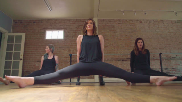 tricep dip in fitness classes - barre stock videos and b-roll footage