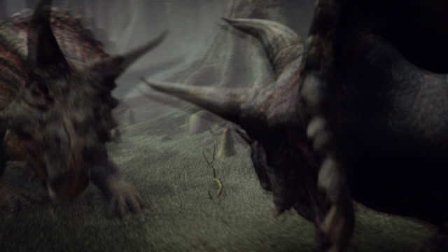 triceratops dinosaurs fight in a forest in a computer-generated animation. - triceratops stock videos and b-roll footage
