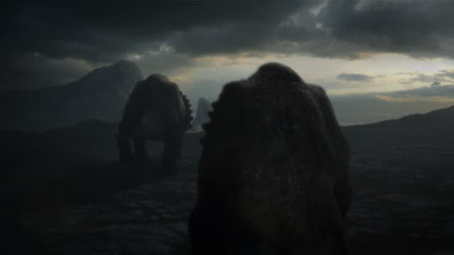 triceratops walk across a blasted wasteland where storm clouds loom over a rocky horizon. - triceratops stock videos and b-roll footage