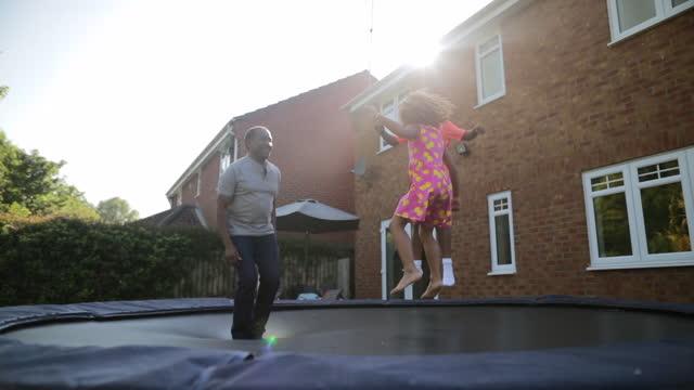 tricks on the trampoline - medium shot stock videos & royalty-free footage