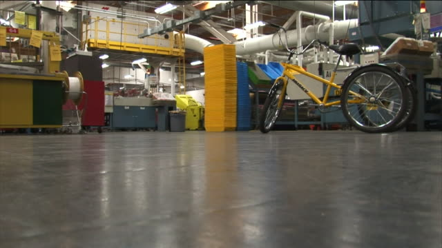 a tricycle and other equipment fill a postal service warehouse. - tricycle stock videos & royalty-free footage