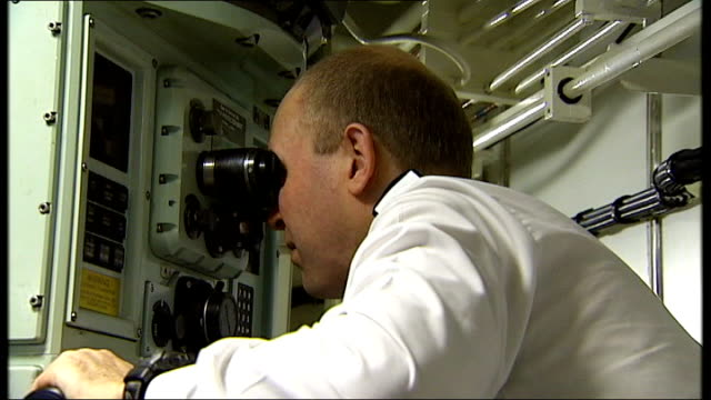 hms vigilant chef in galley of submarine officer lifting himself up into top bunk in living quarters ballard looking into periscope royal navy... - galeere stock-videos und b-roll-filmmaterial