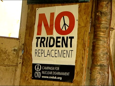 peace camp no trident replacement poster on side of shed adam conway interview sot - replacement stock videos & royalty-free footage