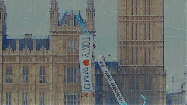 trident nuclear programme vote; graphicised seq treated footage of tony loves wmd banner against houses of parliament / greenpeace protestors on... - weapons of mass destruction stock videos & royalty-free footage