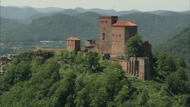 aerial trifels castle on hilltop, annweiler, rhineland, germany - north rhine westphalia stock videos & royalty-free footage