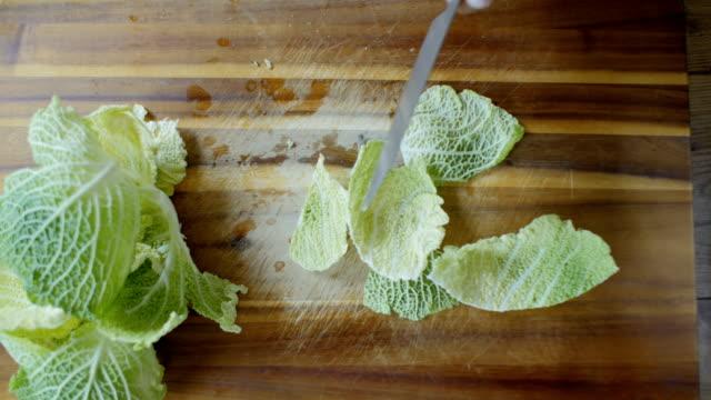 trim savoy cabbage - savoy cabbage stock videos & royalty-free footage