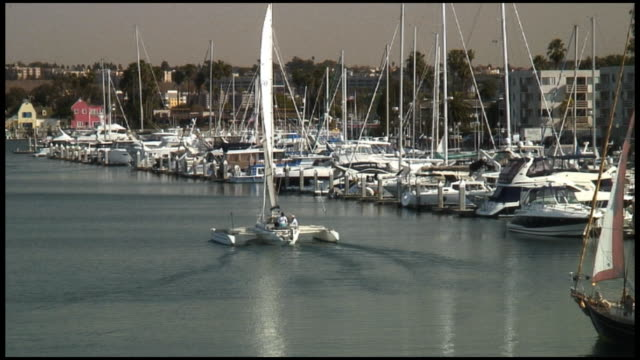 (HD1080) Trimaran and Sailboat in Marina, Harbor, Harbour, Bay