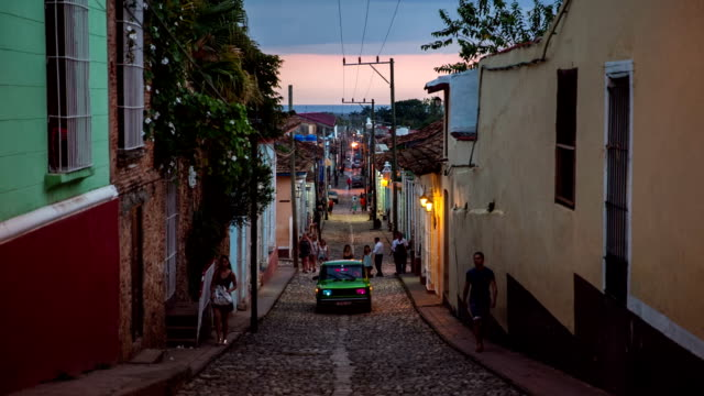 trinidad city street with colonial houses at dusk , cuba - cuba stock videos and b-roll footage