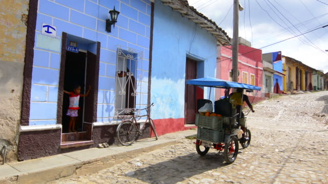 Trinidad Cuba cobblestone street of second oldest city in Cuba as colonial town with colorful buildings