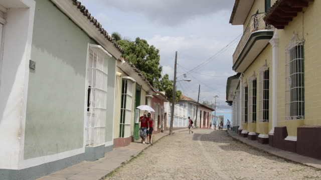 trinidad cuba cobblestone streets with people moving and relaxing in their lives - sancti spiritus province stock videos and b-roll footage