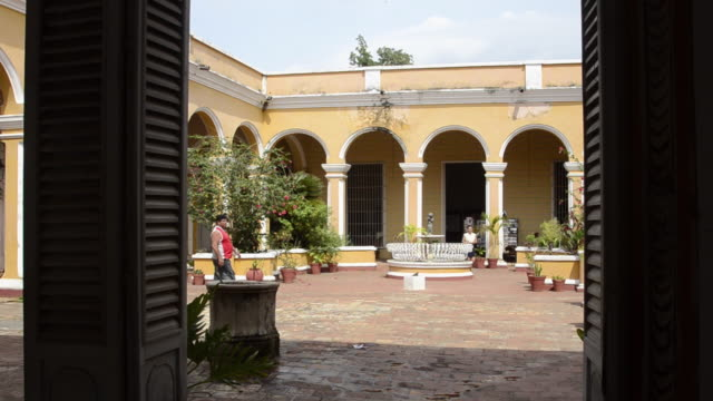 trinidad cuba interior courtyard with people and arches and beautiful architecture - sancti spiritus province stock videos and b-roll footage