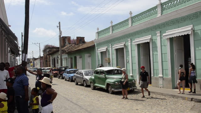 trinidad cuba life on the main cobblestone street with colorful buildings and people - sancti spiritus province stock videos and b-roll footage