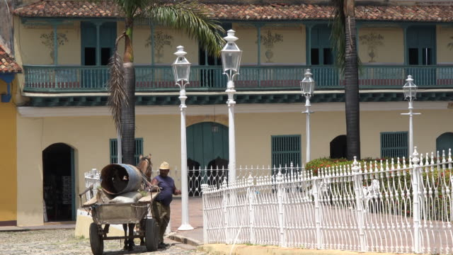 trinidad, cuba: old spanish colonial architecture and lifestyle in the main plaza of the unesco world heritage site - one mid adult man only stock videos & royalty-free footage
