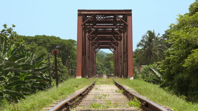 Trinidad, Cuba: old vintage iron bridge in the Cuban countryside. Beautiful blue and green colours of the tropical climate