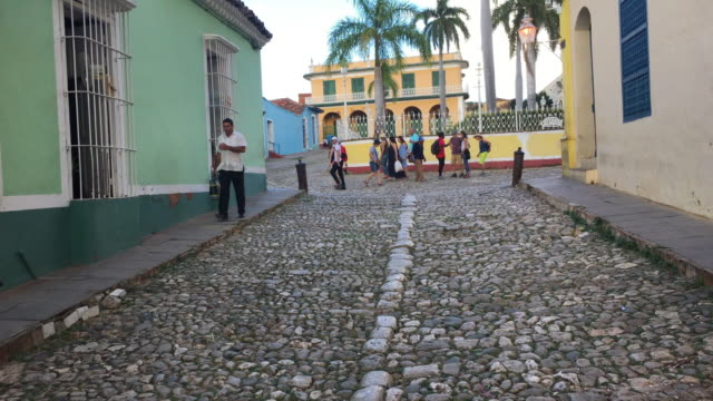trinidad, cuba, walking in the cobblestones streets of the colonial landmark - cobblestone stock videos & royalty-free footage