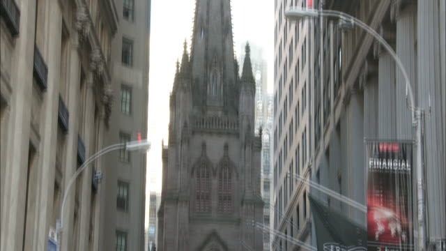 trinity church building & spire on broadway in lower manhattan. nyc, downtown, aka trinity wall street, trinity place, church, episcopal diocese of... - spire stock videos & royalty-free footage