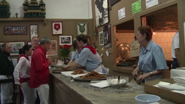 a trip to a family business thats been producing tasty churros since 1872 has become a right of passage for anyone running with the bulls in... - churro stock videos & royalty-free footage